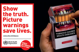 Tobacco pack with image of damaged teeth caused by tobacco