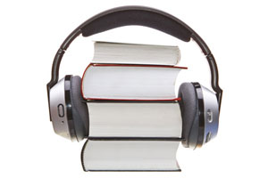 A pair of headphones on a stack of books