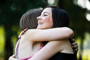 Two young women embracing
