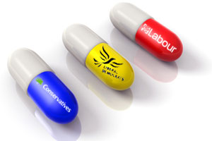 Three pills - one yellow, one blue, one red - each identifying a major UK political party