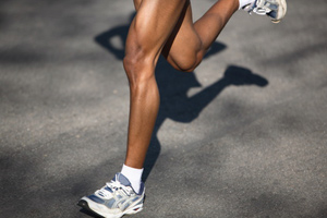 Close-up of a runner's legs