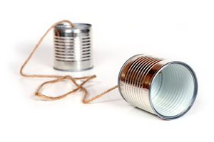 Two tin cans held together by string