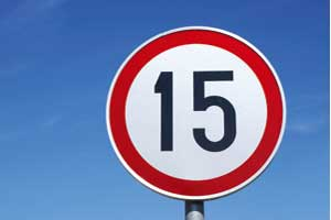 A road sign indicating a speed limit of 15 kph