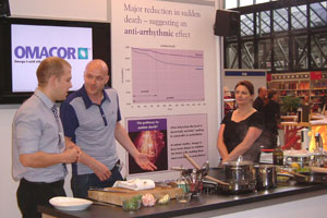Chefs demonstrates how to cook fish to conference delegates