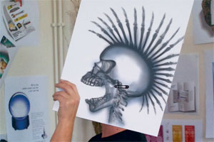 A man in profile holding a skull x-ray in front of his head
