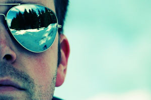Close up of a man's face wearing sunglasses