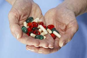Cupped hands containing various pills