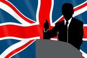 A silhouette of a politician giving a speech in front of the UK flag