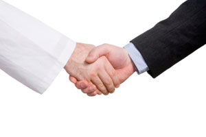 A handshake between a scientist and a businessman