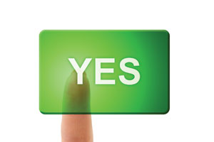 A finger pressing a button saying 'yes'