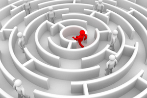 A figure running to the centre of a maze