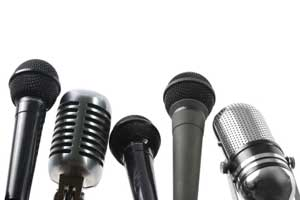 A collection of microphones set up for an interview