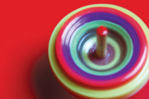 A spinning top on a red background