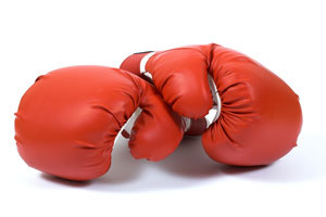 A set of boxing gloves against a white background