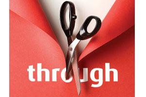 A pair of scissors cutting through the word 'through'