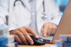 A doctor using his computer
