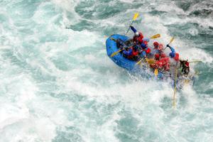 A raft sailing down a river