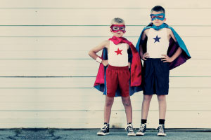 Two children in superhero outifts