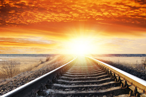 Sun rising over train tracks
