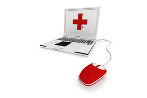 A laptop with a red cross sign on the screen