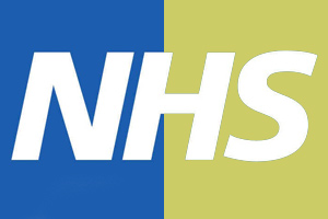 The NHS logo, half against a yellow background, half against a blue background