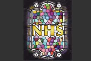 Stained glass window spelling NHS