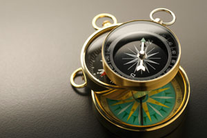 Several compasses piled on top of each other