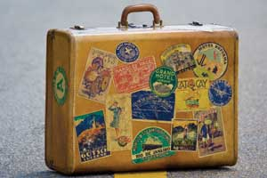 Suitcase with several destination labels