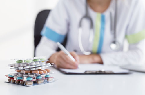Doctor writing prescription for medicines