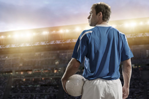 A footballer looking out onto the pitch