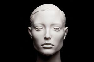 A sculpture of a female face