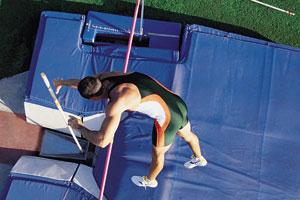 A pole vaulter jumping over a bar